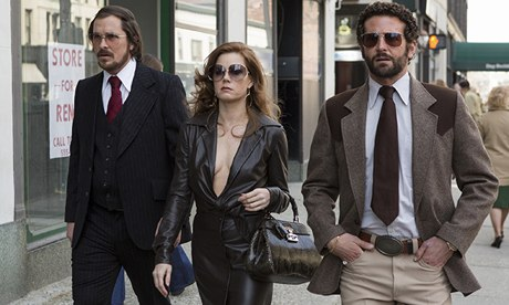 American Hustle: Christian Bale, Amy Adams and Bradley Cooper walking in street